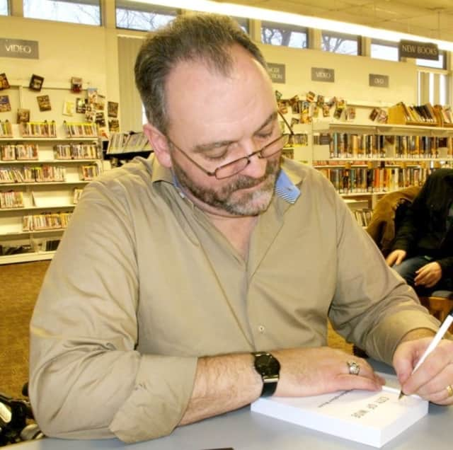 Volunteer Chris Ryan helps out at the library. The Ridgefield Park Library is looking for assistance in many areas.