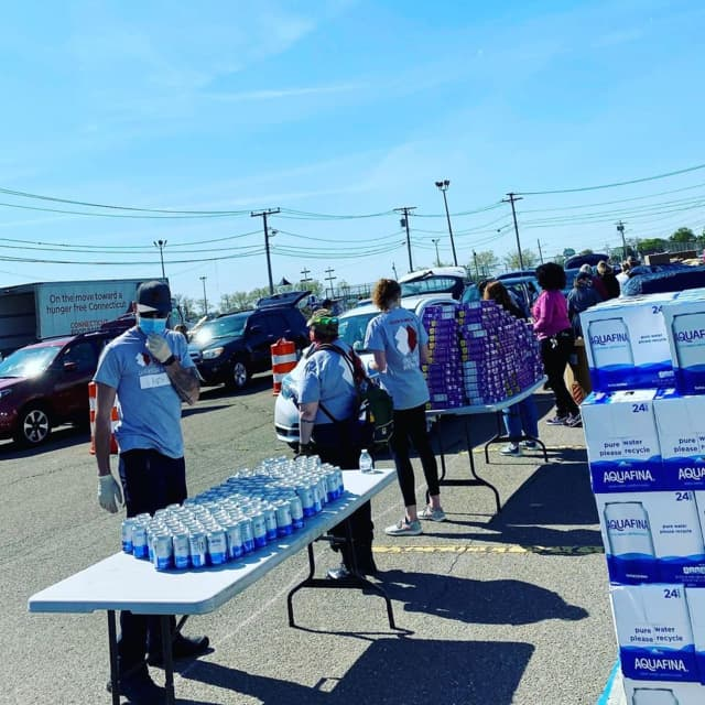Hundreds of cars lined up to receive food during an event sponsored by the Connecticut Food Bank.