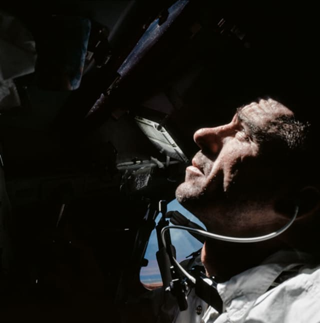 © APOLLO VII-XVII, to be published by teNeues in September 2018, € 50, www.teneues.com, Apollo 7, Walt looking out of the Command Module window during their 11-day orbit around the Earth. (AS07-04-1584), Photo © courtesy of The National Aeronautics and Space Administration (NASA) photographic archives