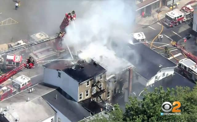 Aerial ladders at work in the Cianci Street fire in Paterson.