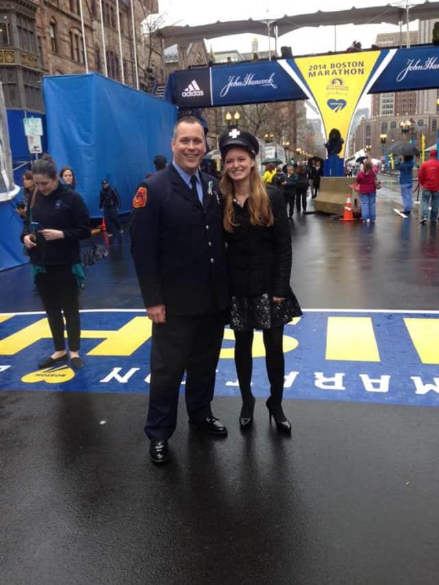 Victoria McGrath and Jimmy Plourde at the Boston Marathon finish line.