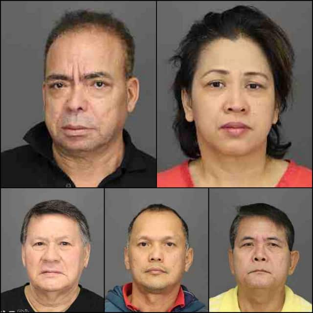 Six employees at the Century Golf Club in Purchase are charged with scamming more than $100,000 in unemployment benefits while they were overseas.