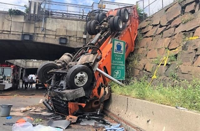 The truck went off the Palisade Avenue overpass and landed nose-first on Route 495 in Weehawken.