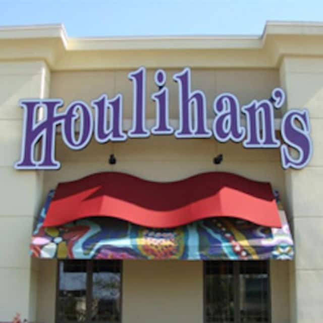 The owner of several Houlihan's restaurants is accused of keeping thousands in tips.