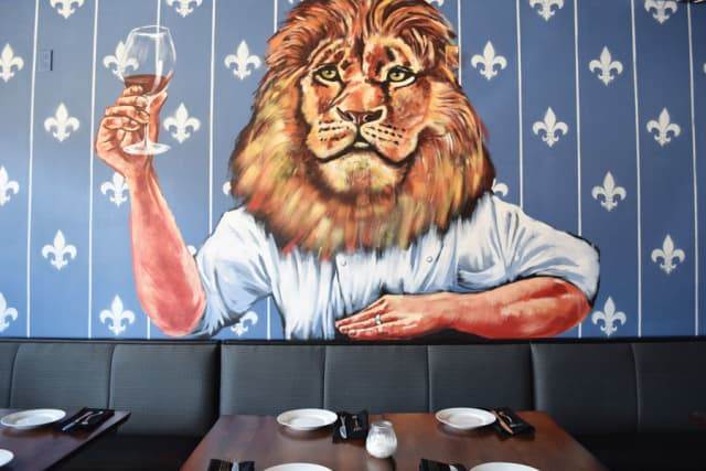 A mural inside Único represents chef and owner Brian Sernatinger.