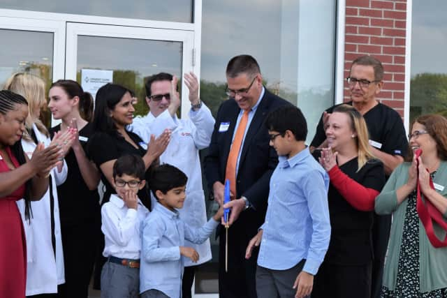 The official ribbon-cutting at the grand opening of AFC Urgent Care in Shelton on Monday. See story for IDs.