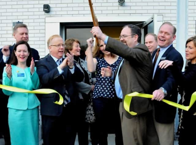 AFC Urgent Care Danbury co-owners Tom Kelly, holding the scissors, and Ron Krippner, second from right, cut the ribbon at the grand opening of their Main Street clinic in Danbury in 2013. AFC plans to open its third location in the city in February.