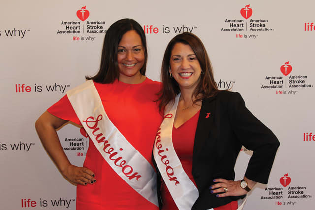"""Christine Wayne of Stamford and Kim Salveggi of Yorktown Heights, from left, both survivors and advocates for """"Go Red,"""" at the 2017 Go Red for Women Luncheon. Courtesy American Heart Association."""