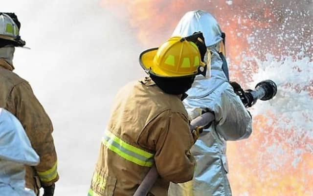 Spraying a fire with AFFF creates a film that coats the fire, blocking its oxygen supply and preventing re-ignition.