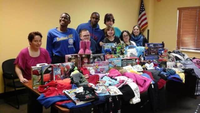 Volunteers from ARC of Rockland's Day Habilitation Department spread joy during the recent holidays by helping to collect toys and clothing for needy children. The nonprofit is sponsoring a free life-care planning workshop in March.
