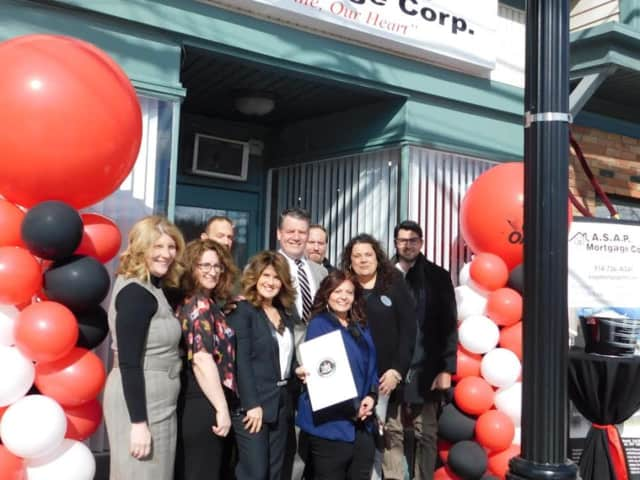 Sen. Terrence Murphy,  center with tie, attends the ribbon-cutting for A.S.A.P. Mortgage's Croton offices. With him are, l-r: Donna Doria, Camille Campbell, Steve Cahn, Irene Amato, David Best, Marie Ingrassia, Nancy Meserole, and Richard DelGrosso.
