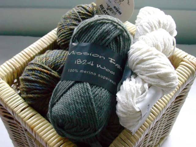The senior group, Crafty Sisters, meets weekly to knit items to be donated.