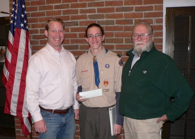 Thomas Shiskin, a member of Monroe Boy Scout Troop 62, with Aaron McGoldrick, left, president of the land trust, and Karl Witalis, president emeritus.