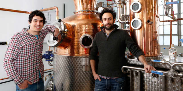 Owners Yoni Rabino and Noah Braunstein of Neversink Spirits in Port Chester are featured in a New York Times article about their distillery.