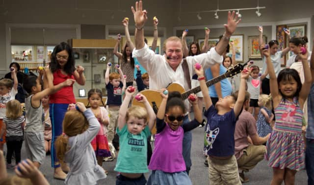 "Westport is putting the finishing touches on its ""First Night"" festivities. One of the many talented performers helping it ring in 2017 will be Al deCant, aka The Singing Principal, shown here with little superstars at the Woodbridge Town Library."