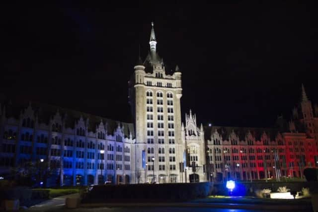 The SUNY Administration Building in Albany bathed in the colors of the French flag Saturday night.