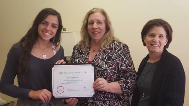 Aline DiMella, left, raised $1,400 to fund yoga classes for women battling cancer.