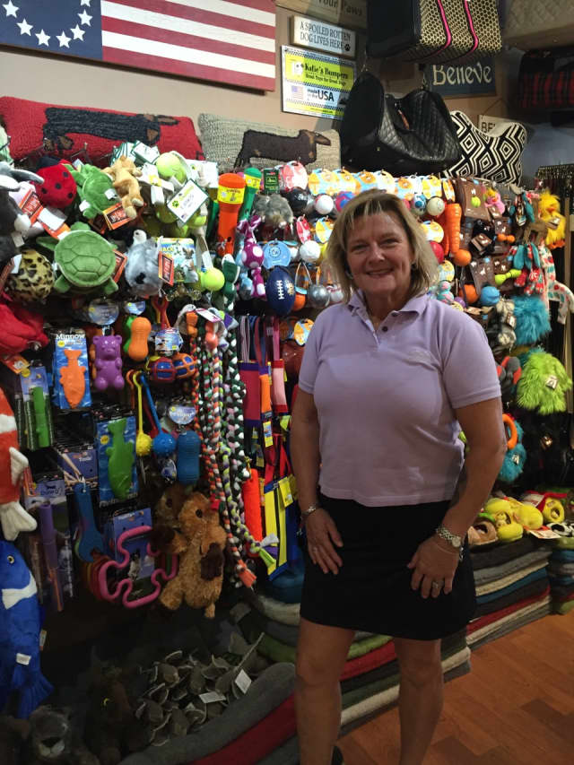All Paws owner Claudia Baker displays her wide variety of dog toys.