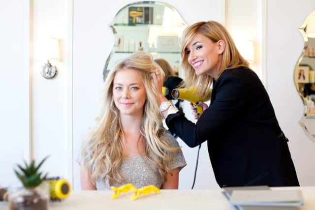Alli Webb, founder of Drybar, works with a client.