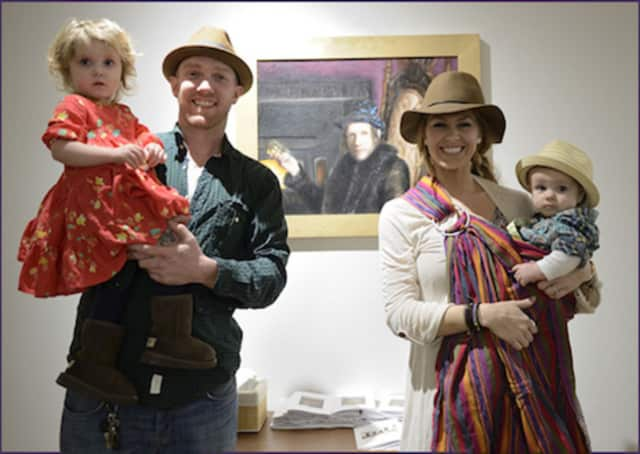 Drew Miller, shown with his family, displayed artwork in last year's University of Bridgeport alumni show.