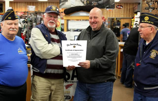 Commander Phil Langner of American Legion Post 162 present Legion Appreciation Certificate to Craig Smith of Rugged Outfitters in Park Ridge.