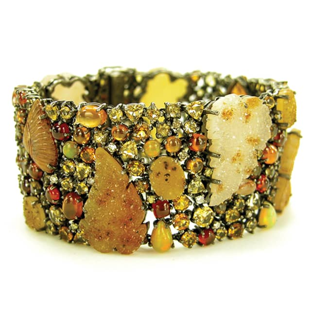 A bracelet made with hand-carved Brazilian drusy agate leaves accented with hessonite and topaz and garnet accented with white and yellow diamonds. Image courtesy Amy Kahn Russell.