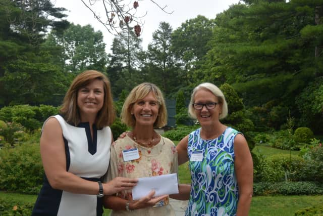 Barbara Fitzpatrick, Director of STAR's Rubino Family Center and Birth to Three Program is flanked by Carrie Bernier and Amy Wilkinson from The Community Fund of Darien.