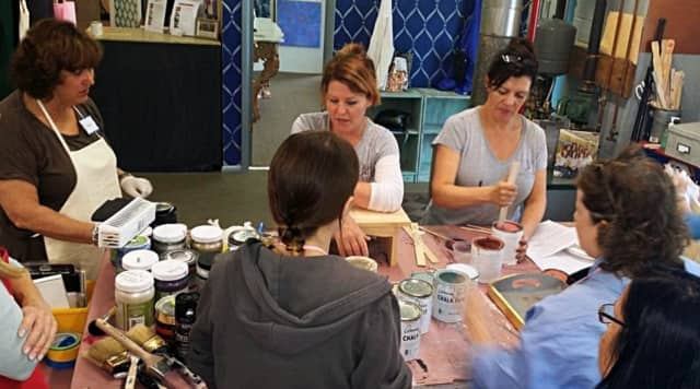 Faux Time Design owner Angela Schuster demonstrates the step-by-step process with Annie Sloan chalk paint.