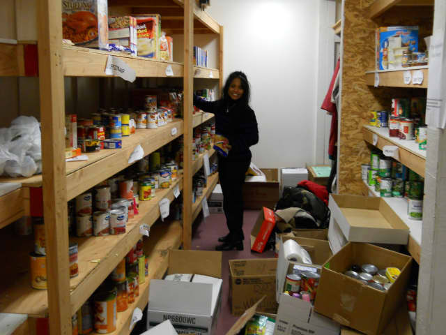 Bergenfield Social Services co-director AnneMarie DellaCruz organizing donations in 2012.