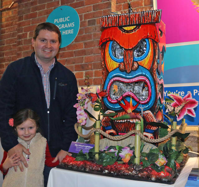 """Brett Almstead, of Ridgefield, with daughter, Marin, with his second-place winner, """"Tiki Island Lighthouse,"""" in The Maritime Aquarium at Norwalk's 14th annual """"Festival of Lighthouses Contest."""""""