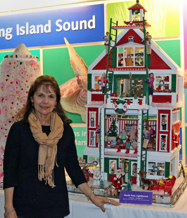 """Jo Stecker, of Norwalk, with her fifth-place winner, """"North Pole Lighthouse,"""" in The Maritime Aquarium at Norwalk's 14th annual """"Festival of Lighthouses Contest."""""""