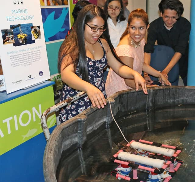 Visitors play at one of the exhibits at The Maritime Aquarium in Norwalk. The aquarium, which draws about 500,000 visitors a year, has just received a large grant to educate the public about climate change and other pressing environmental issues.
