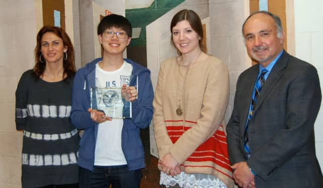 From left: Art teacher Celia Golub, SunWoo Kim, art teacher Laura Kipilman, and Principal Bruce Sabatini.