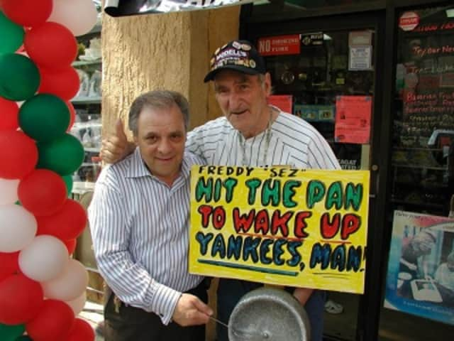Anthony Artuso Sr., left, hams it up in 2010 with Freddy Schuman, the Yankees' late unofficial mascot. Artuso, of the famed pastry makers of the same name, has reopened his baked goods operation in Mount Vernon after a devastating 2014 factory fire.