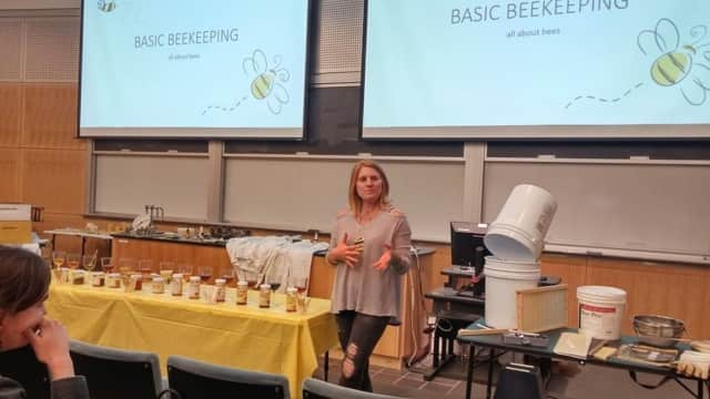"WestConn Permaculture Garden Intern Ashley Kenney discusses beekeeping at a ""Farm for Yourself"" lecture presented by the Jane Goodall Center this spring."