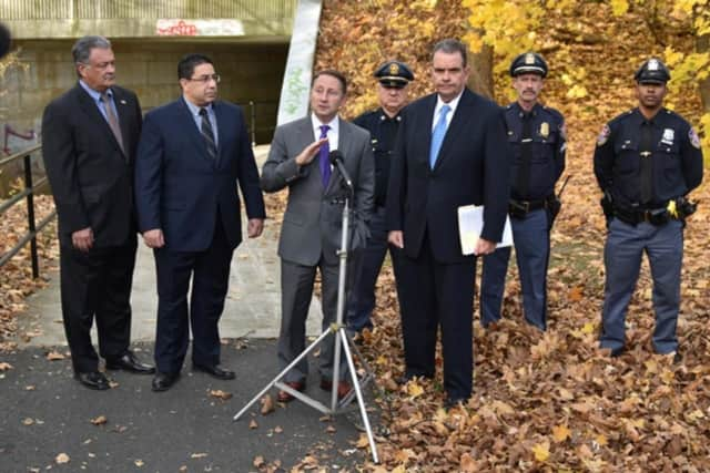 Rob Astorino, at microphone, reacts Monday to racist slurs and symbols that were found scrawled on a bike path in White Plains. Saying hate crimes will not be tolerated, the county executive vowed that the perpetrators will be found and punished.