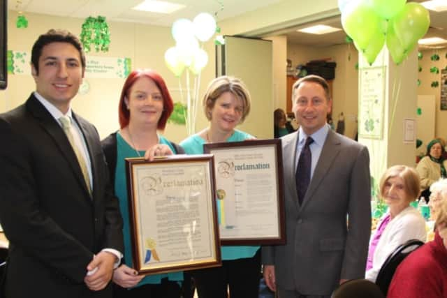 Westchester County Executive Robert P. Astorino (right) and Legislator David Tubiolo (left) present proclamations to Órla Kelleher, executive director of the Aisling Irish Community Center, and Caitriona Clarke, chairperson of the board.