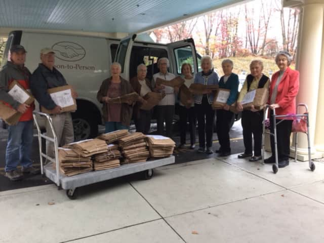 Person-To-Person Volunteers Rick Nixon and Ed Mulock with Atria residents Marion Snyderman, Sally Donohue, Pat Hartnett, Dottie Kesten, Waldo Jones, Peg Brewer, Helen Antrim, and Dot Nollman.