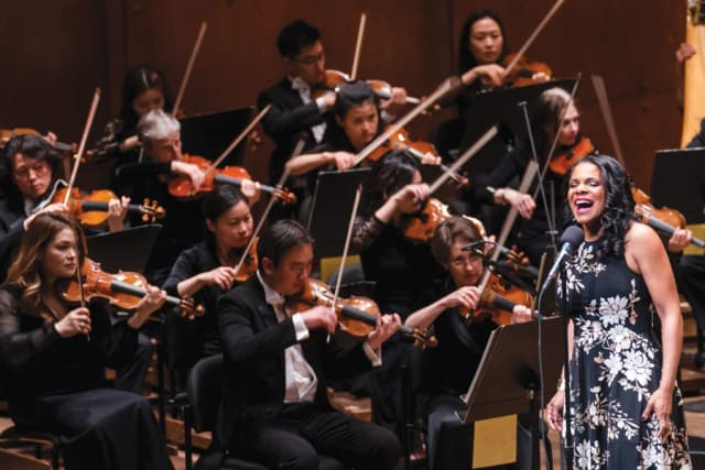 Audra McDonald with the New York Philharmonic. Photograph by Chris Lee.