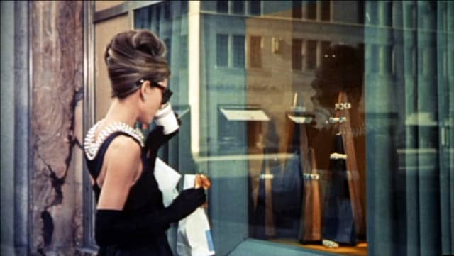 """Audrey Hepburn in the iconic opening of """"Breakfast at Tiffany's"""" (1961)."""
