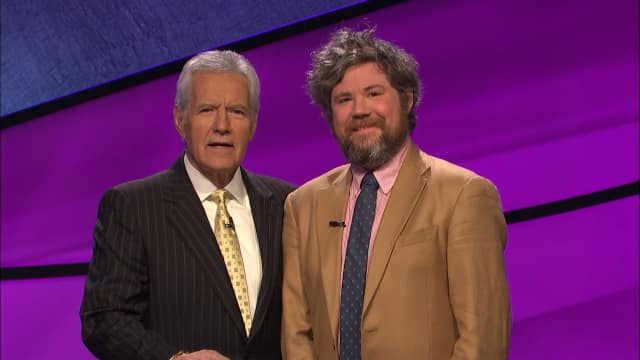 "Austin Rogers, at right, with ""Jeopardy!"" host Alex Trebek"