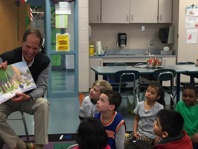 George Schott of Legg Mason reads to kindergarten students at Westover Magnet Elementary School during the annual Business to Books Read-a-Thon in Stamford.