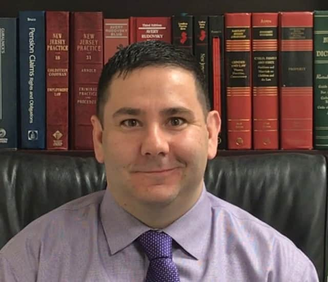 John Barone is a former EMT and police officer turned lawyer in Hasbrouck Heights.