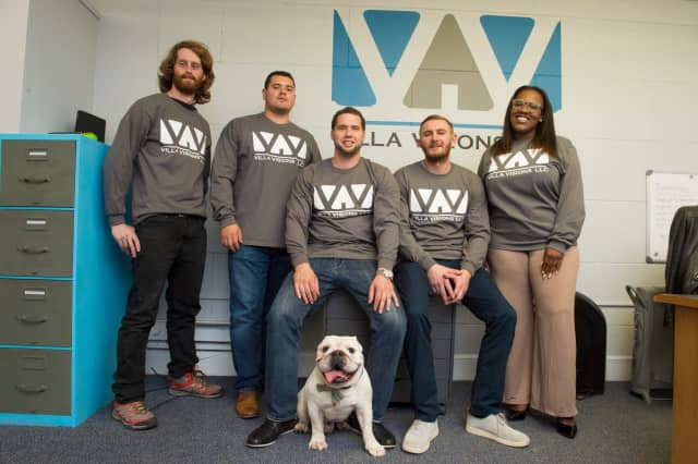 Travis Soine of Rutherford, center, and the Villa Visions team — plus company mascot, Nicks.