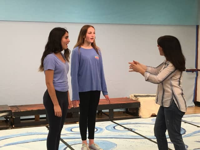 "Briarcliff Middle School students portraying Ariel and Ursula rehearse for this week's performances of ""The Little Mermaid Jr."" with musical director Regina Leon."