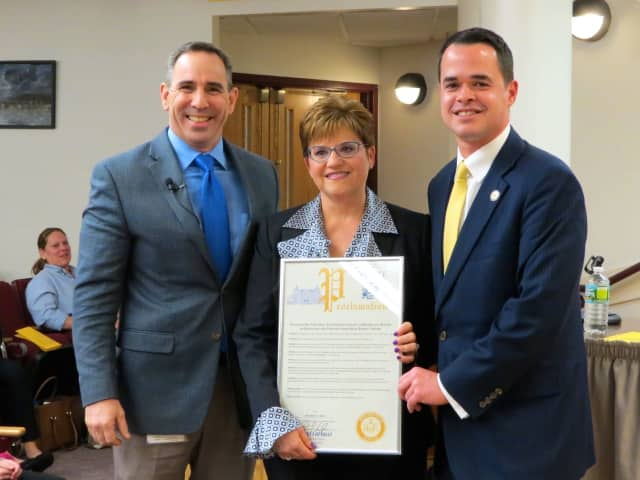 Briarcliff Manor Superintendent of Schools Dr. James Kaishian, Todd Elementary School Principal Nadine McDermott and New York State Senator David Carlucci with the New York State Senate proclamation honoring Todd as a 2016 National Blue Ribbon School