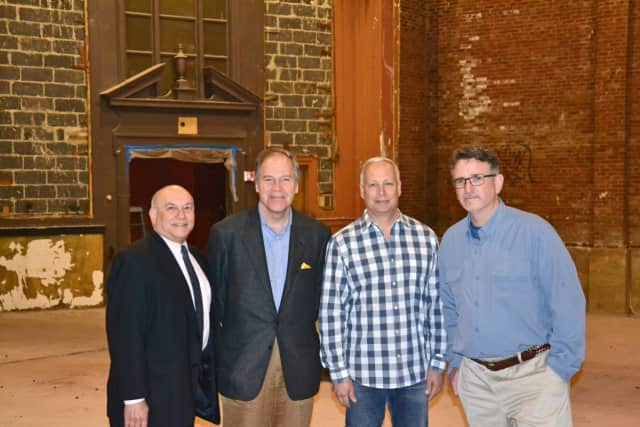Chris Burdick, Bedford Town Supervisor, John Farr, Bob Torre and Darren Mercer in the current Bedford Playhouse. Work is scheduled to begin shortly on the building's renovations.