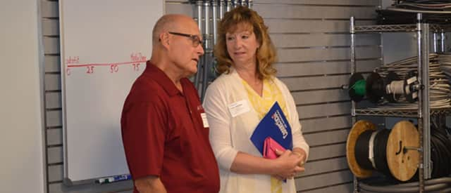 State Rep. Laura Hoydick speaks with Don Erickson, the owner of Albert E Erickson Co. in Stratford, a small manufacturer.