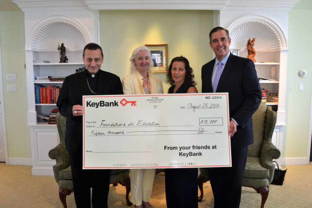 Bishop Frank Caggiano; Holly Doherty-Lemoine, Executive Director of the Foundations in Education; Bonnie Geppert and Matt Fair of KeyBank