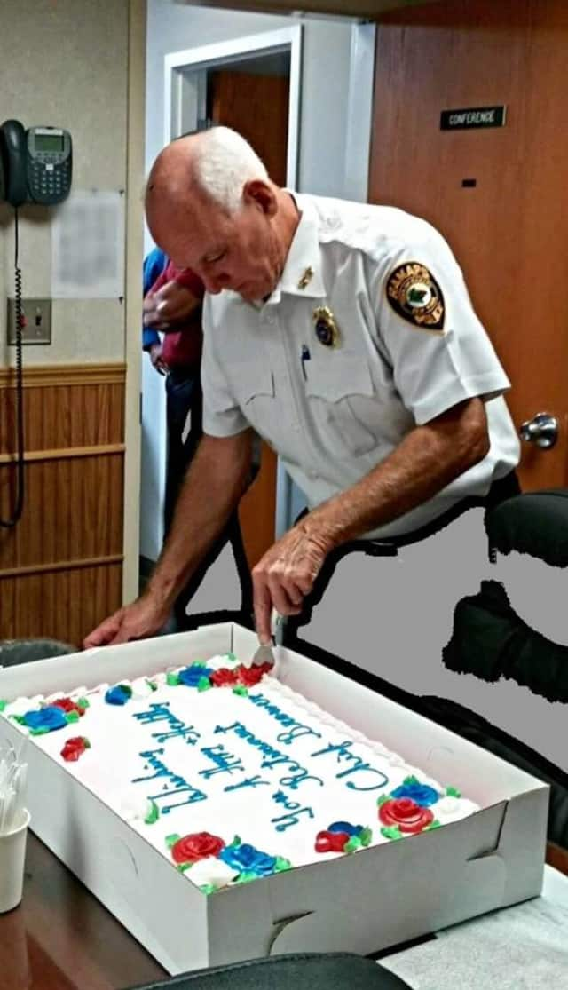 Ramapo police Chief Peter Brower cuts a cake at his retirement party.